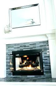 tile fireplace surround black and white mosaic