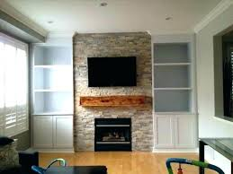 stone fireplace with built ins fireplace with above and bookshelves stacked stone fireplace with above rock stone fireplace with built ins