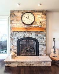 wood mantel on stone fireplace cultured stone living room transitional with wood mantel raised hearth fireplace wood mantel on stone fireplace