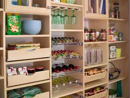 organized kitchen pantry with wood cabinets