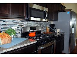 kitchen backsplash glass tile dark cabinets. Beautiful Cabinets Granite Countertops Glass U0026 Stone Backsplash Tile And Stainless Steel  Appliances Brighten Up Dark Birch Cabinetry To Kitchen Backsplash Glass Tile Dark Cabinets C
