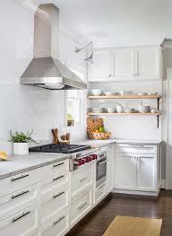 kitchen with full height subway tiled backsplash