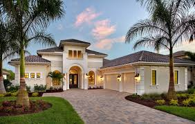 great exterior home colors. inspiration for a mediterranean beige one-story exterior home remodel in miami great colors