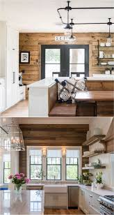 a pallet wall can be used as a great accent wall the natural wood wall adds warmth to a black and white kitchen or a room with splashes of color