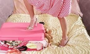Bildresultat för packad resväska