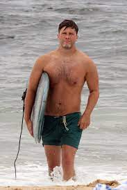 Colin Jost spotted surfing shirtless in ...