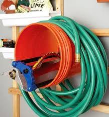 garden hose caddy. Sprinkler-holder-and-garden-hose Garden Hose Caddy