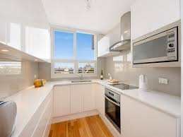 kitchen floor ideas on a budget. U Shaped Small Kitchen Designs With White Cabinet And Wooden Flooring Ideas For Modern Apartment Decor Floor On A Budget