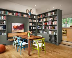 Inspiration for a contemporary medium tone wood floor dining room remodel  in Austin with green walls