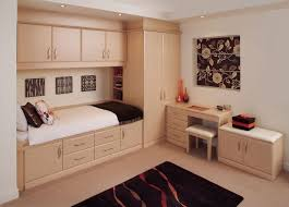 Built in bedroom furniture designs Childrens Bedroom Fitted Alluring Fitted Bedroom Furniture With Wooden Closet Chest Of Drawer Also Flower Paintings On Black Background Kyeanorg Bedroom Alluring Fitted Bedroom Furniture With Wooden Closet Chest