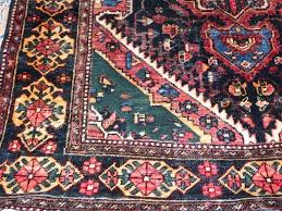 a beautiful vintage bakhtiari persian hand woven rug in cape town