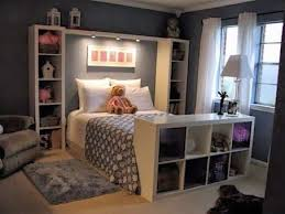 Bed surrounded by shelving units