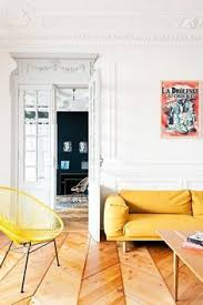 a chic french apartment for you to tour home interior decor decoration yellow coach wood floors living room