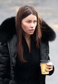 this is a picture of sofia vergara walking the streets early in the morning after getting access to her daily morning coffee she sports a makeup free look