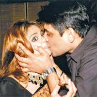 But starlet Amita Nangia doesn't seem consenting, as hubby, Sanjay Bansal grabs her for a kiss. The verdict: it's a recipe for disaster. - tv5