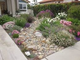 Xeriscape Small Front Yard  Difficult Slope Is Tamed With Stone Lawn Free Backyard