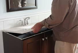installing bathroom vanity. once the top is off, locate and remove any screws holding vanity in place, these are usually at rear of along area known as installing bathroom