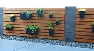 diy wood slat garden wall with planters