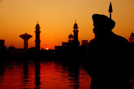 the harmandir sahib golden temple in amritsar photo essay this guard is rendered as a silhouette during sunrise