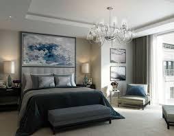 gray bedroom with chandelier
