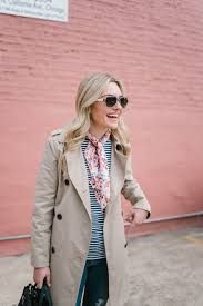 blogger bows sequins wearing a tan old navy trench coat a fl scarf
