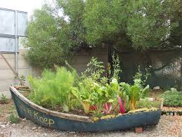 15 Unusual Vegetable Garden Ideas - Vegetable garden in a boat