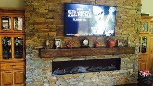 living room with electric fireplace and tv. Electric Fireplace TV Mounted On Wall Stone Surround Wood Mantle Living Room With And Tv