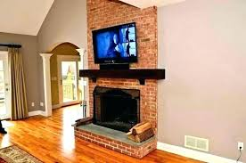 architecture mounting above fireplace elegant hanging your over the yea or nay tv side by aspiration view in gallery tv above fireplace