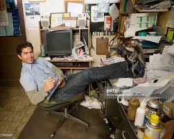 office in garage. Hispanic Mechanic In Garage Office : Stock Photo