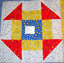 this is hole in the barn door sle block it is made with four colors very pretty geometric design please excuse the pinned to the middle part of