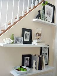floating shelves on staircase wall