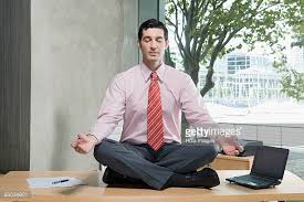 office meditation. businessman meditating in an office meditation o