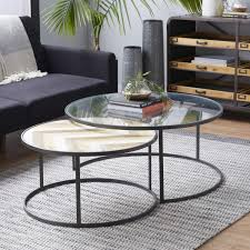 Today's contemporary coffee table sets come in a wide variety of colors, shapes, materials, and designs. Amazon Com Deco 79 Large Contemporary Metal Glass Wood Nesting Round Coffee Tables Set Of 2 2 Piece Furniture Decor