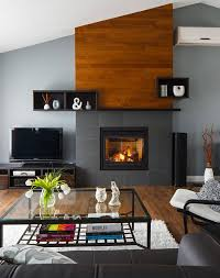 specifically i love the juxtaposition of the grey tiles on the fireplace surround and the timber