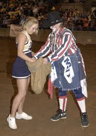 File:US Navy 031229-N-0399H-039 U.S. Naval Academy Cheerleader Midshipman  4th Class Jaime Bradley, from The Woodlands, Texas, picks a cow chip from a  bag held by a rodeo clown in Reliant Arena.jpg - Wikimedia Commons