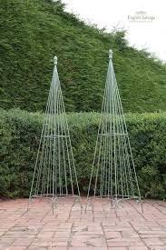 weathered garden obelisk in scroll design