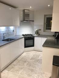 square grey modern vinyl tile kitchen floor black marble countertop white shiny wooden corner cabinet slide in gas ranges wall mount range hoods pull down
