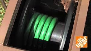 suncast aqua winder automatic rewind garden hose reel the home depot you