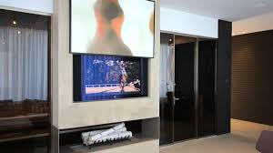 How To Hide Tv Automated Painting Lift To Hide Tv Above Fireplace By Crescendo