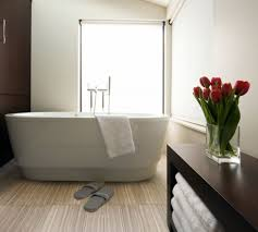 tiles for small bathrooms. Larger-Sized Tiles Make Bathrooms Feel Less Cramped For Small D