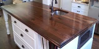 wide plank walnut island countertop cocina charlotte de brun millworks llc