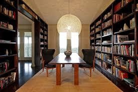 lighting bookshelves. moooi random light above the dining table and dark bookshelves in backdrop design lighting e