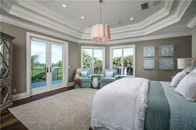 Traditional Master Bedroom with Siscovers Sparkly Square Pillow, Built-in  bookshelf, Hardwood floors