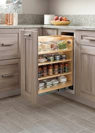 i love the design details in martha s kitchens which enhance storage capacity and facilitate organization such as this pull out rack for es