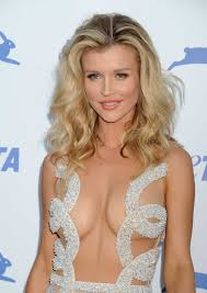 Joanna Krupa is nearly naked at PETA s 35th Anniversary Party in.