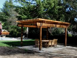 Outdoor Living:Popular Curved Wooden Patio Pergola With Classic Stone  Fireplace Also Stunning Woven Wicker