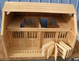wooden toy horse barn and lion photos