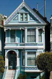beautiful victorian san francisco house in navy blue and white painting with carvings and balcony create
