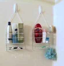 plastic makeup organizer put bathroom: dollar store caddies attached to the shower wall with m hooks