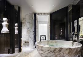 the bathrooms at soho s new ham yard hotel are a mix of granite and oak with double basins a separate shower and a deep cast iron bathtub in most of them